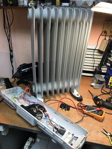 Фото ремонта обогревателя в нашей мастерской